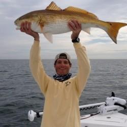 Guy Holding Giant Redfish