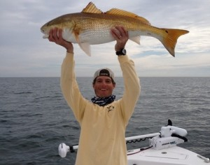 Guy Holding Giant Redfish
